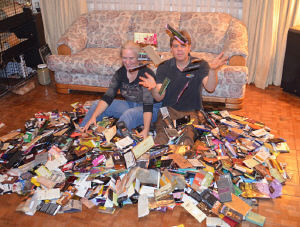 Debbie and Vic Ceder with over 1000 chocolate bar wrappers